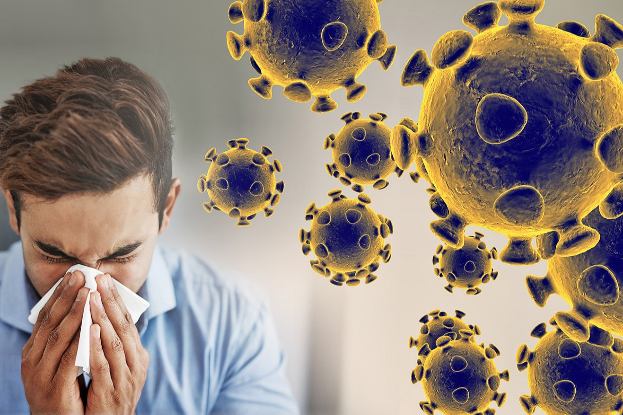 coronavirus - man sneezing into tissue