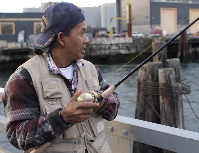 A fisherman on a dock. Photo by: Alex Montalvo of Revel Riter Media