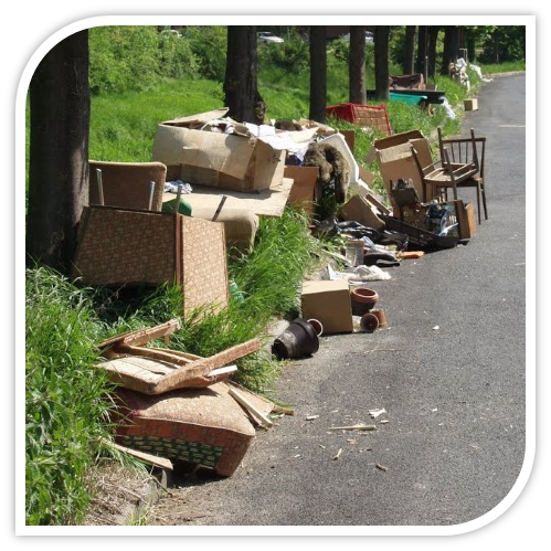 Illegal dumping of garbage on side of road