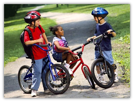 Children wearing bike helmets