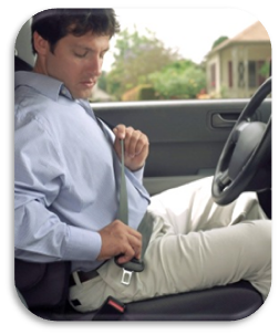 Man putting seatbelt on before driving car