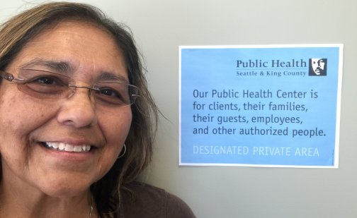 Christina Enriquez with Private Area sign at Auburn Public Health Center