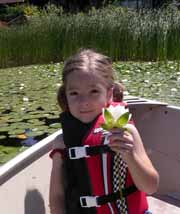 A young lake enthusiast from North Lake holds a water lily.
