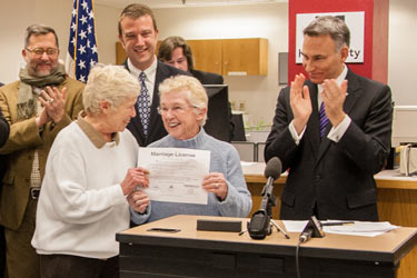 Executive Constantine signs the first same-sex marriage license application