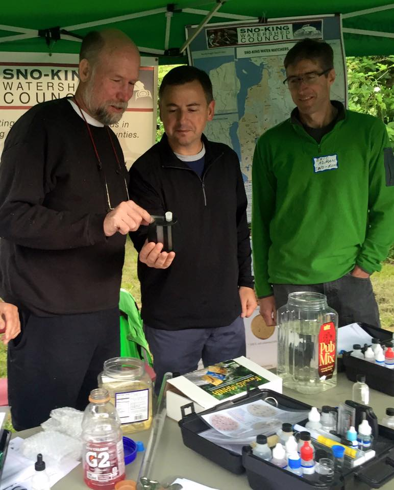 "Council teach Rod about ph and other water quality measuring equipment at the at the ""Influence of the Confluence"" event at Thornton Creek"