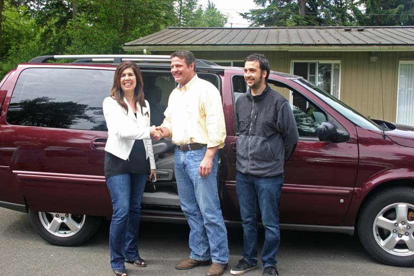 Image: Councilmember Reagan Dunn is joined by Michelle Frets, Director of Programs and Case Manager Kyle Serquinia for the delivery of a surplus County Vanpool Van to the agency