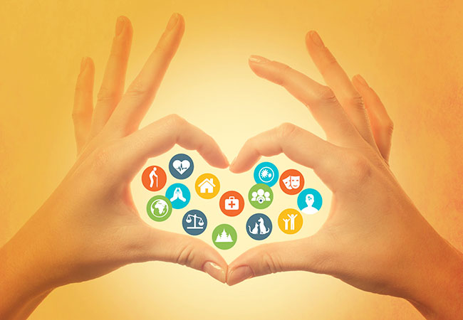 A graphic of hands forming a heart, with icons representing charities in the middle.