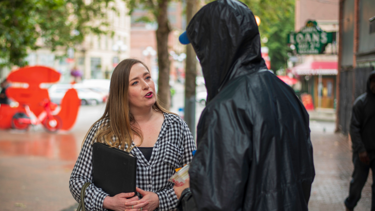 Caseworker and client on the street