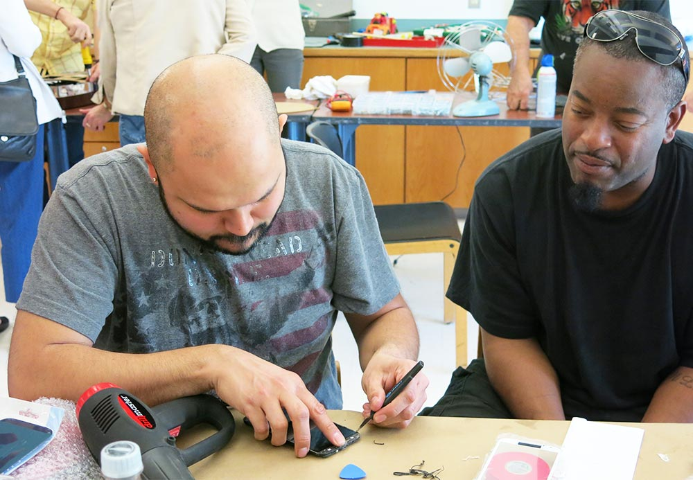 Fixers work on items at one of King County EcoConsumer's Repair events