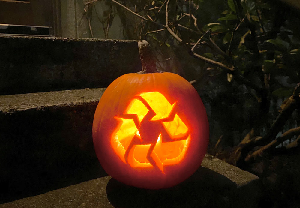 Green & Covid-safe Halloween header - image of jack-o-lantern carved with recycling arrows