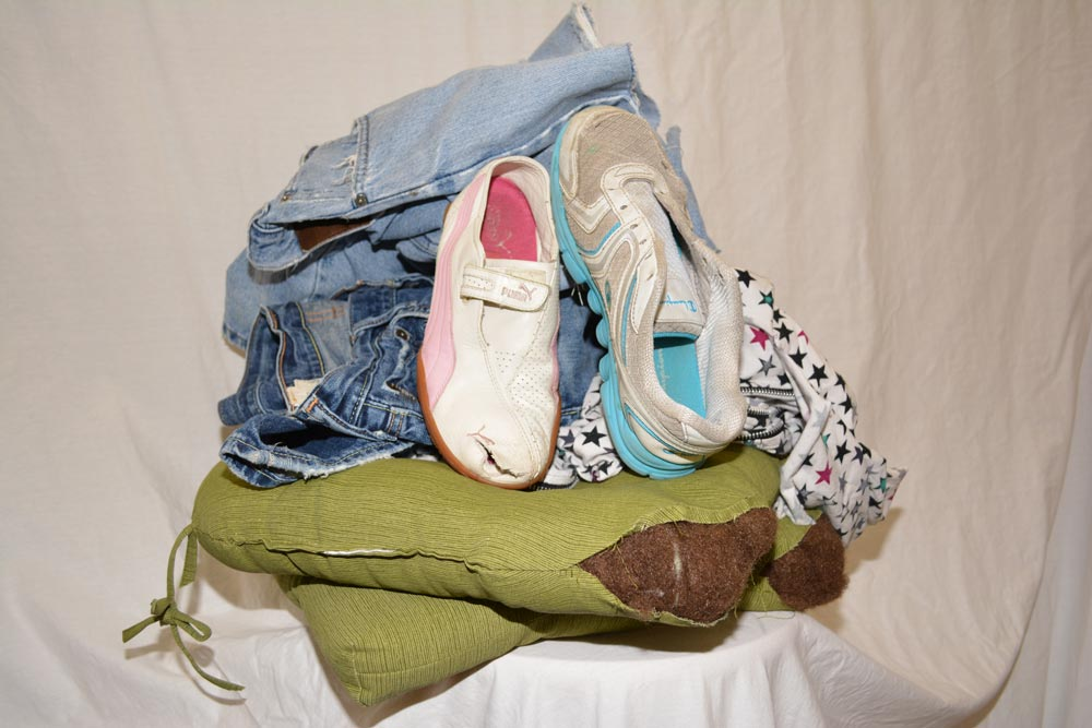 Damaged clothes, shoes, and linens are put into bales and sent to brokers who sort them