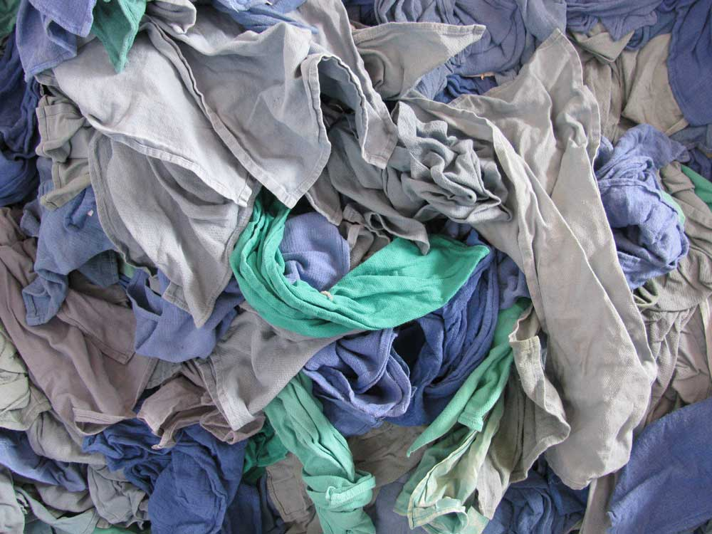 Some damaged clothes and linens are converted into industrial wiping rags