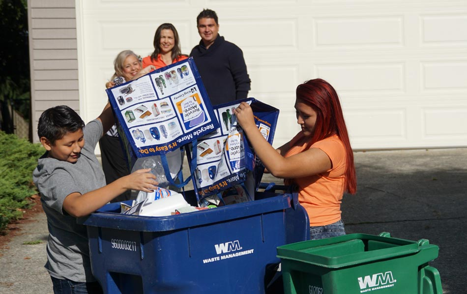 Recycle right - image of family filling recycling curbside cart
