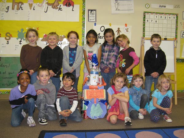 Nautilus K-8 students with recycling trophy