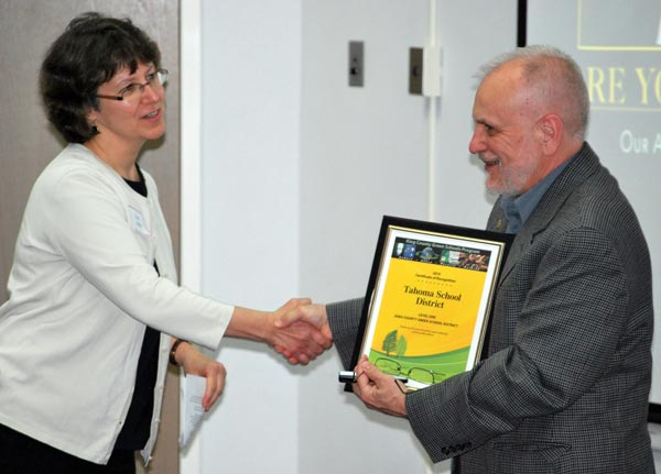 Tahoma School District superintendent Mike Maryanski receives certificate of recognition from Dale Alekel