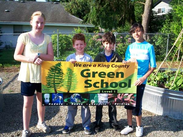 "Sherwood Forest students with their ""We are a Green School"" banner"