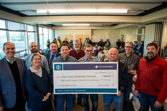 Employees celebrate a $894,970 grant from PSE