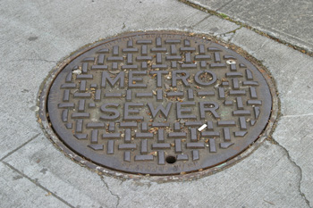Many King County sewer manholes have 'METRO' on the lid.