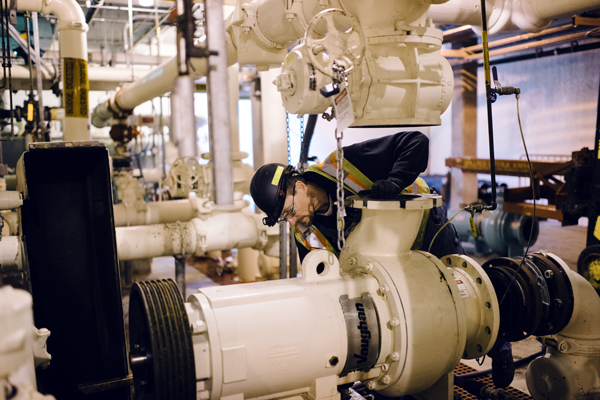 wp-employee-working-on-pump_600