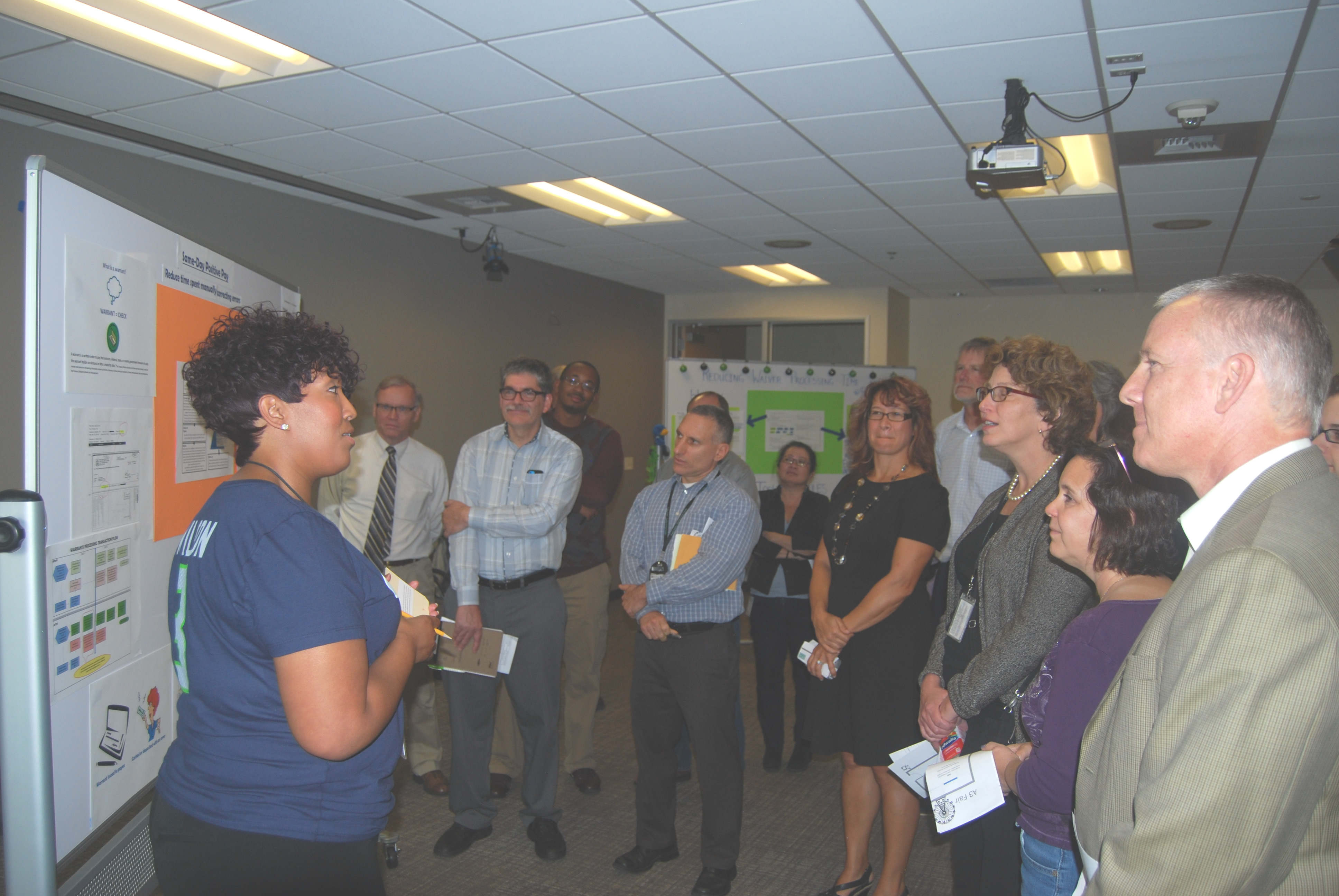 Fiscal Specialist Charla McCoy discusses her A3 project with the audience.