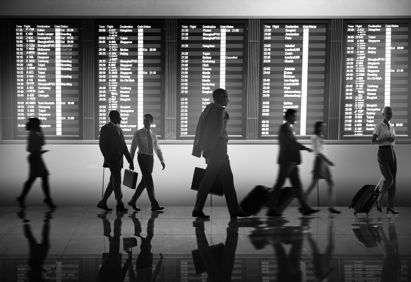 people walking through an airport terminal
