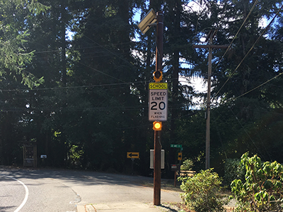 Photo of a flashing beacon in a school zone.