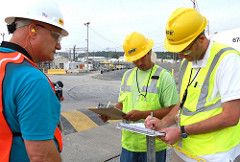Three inspectors review plans at the Savannah River Site.