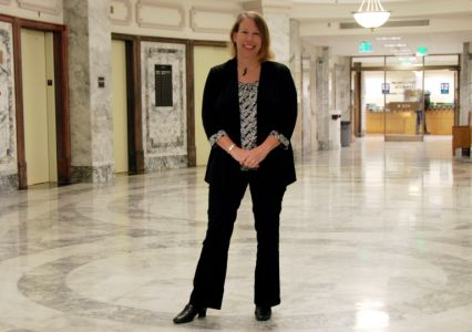 Carla Carlstrom stands in the Rotunda of the Courthouse