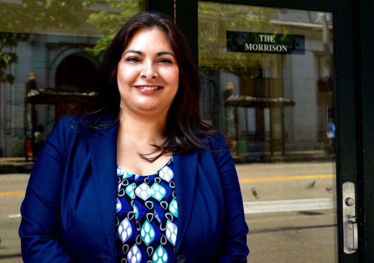 Manka Dhingra poses in front of the Morrison Hotel