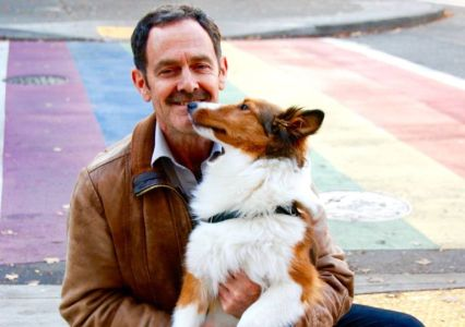 Mike Hogan poses with his dog Lucky