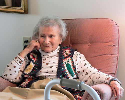 Grandma sitting in a recliner, by Jessica Merz
