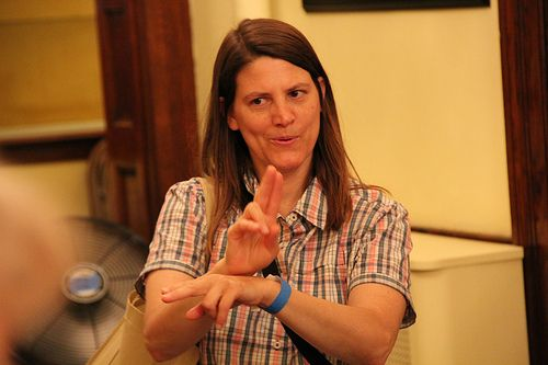 Patricia demonstrates sign language.