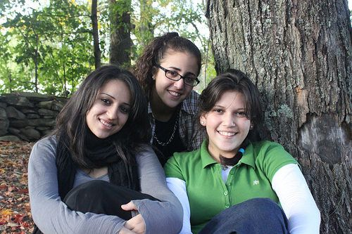 Three teen-age girls sitting by a tree byKars4Kids