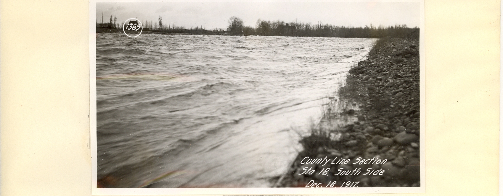 Same section during flood which caused destruction of lower 3600 feet