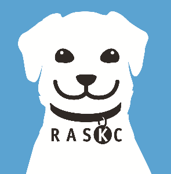 RASKC logo of a dog with a blue background.
