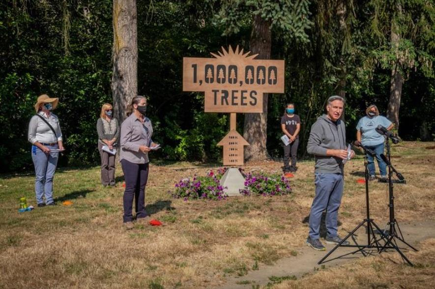 Executive Constantine and partners celebrate the 1 Million Trees initiative at King County's White Center Heights Park where they planted the ceremonial first tree in 2016.