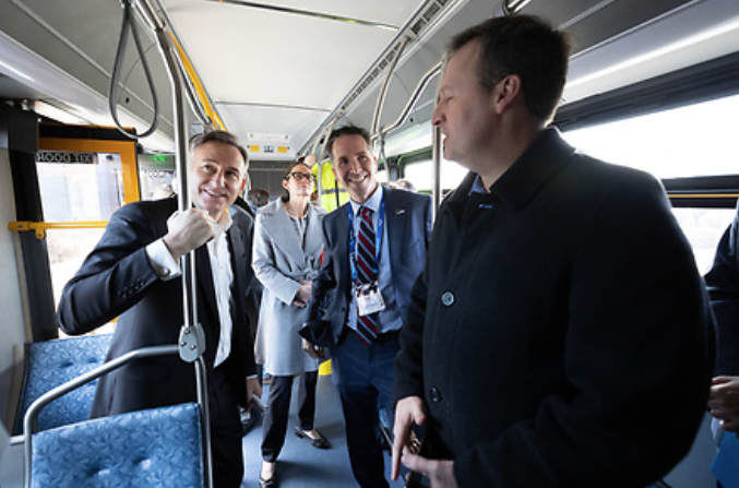 Executive Constantine joins staff and partners aboard one of the long-range battery-powered buses King County Metro will test.