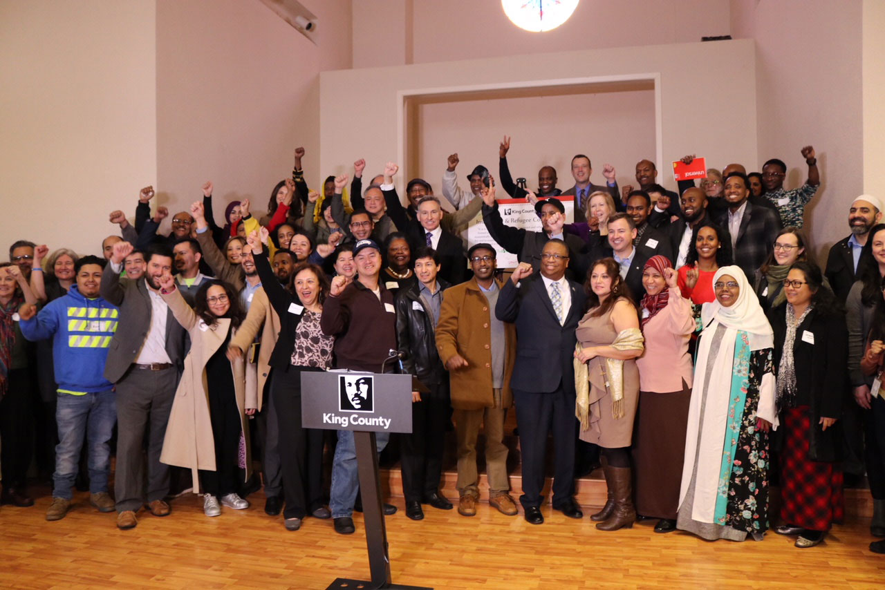 Executive Constantine and members of the County Council join with members of the immigrant and refugee community to celebrate the newly established King County Immigrant and Refugee Commission.