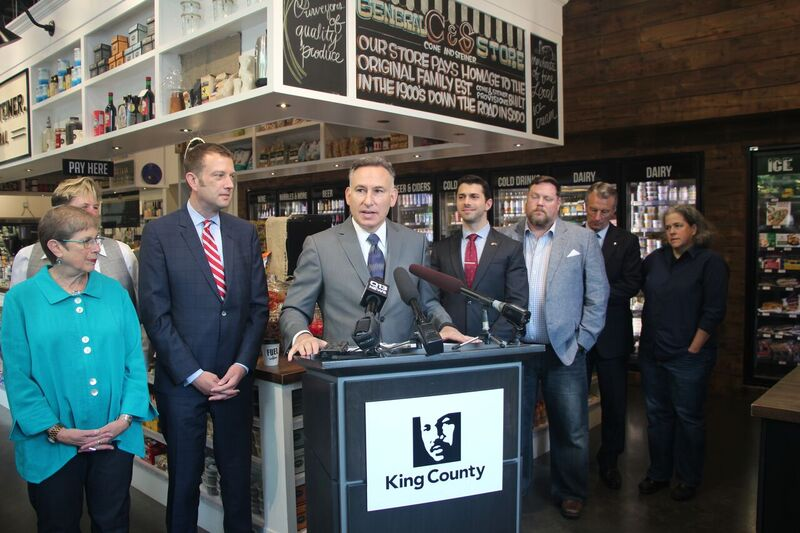 Dow Constantine and public officials at press conference.