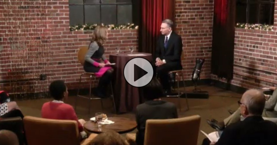 King County Executive Dow Constantine speaks with Joni Balter at a Civic Cocktail event in Seattle.