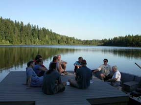 Community members meet on a Spring Lake dock to discuss plans to control milfoil.