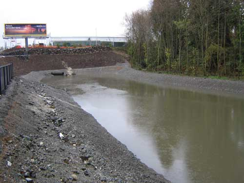 Photo of stormwater detention pond full of water