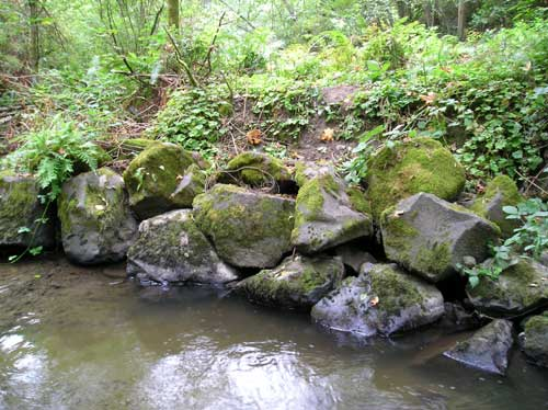 Photo of Miller Creek showing revetment constructed of large boulders