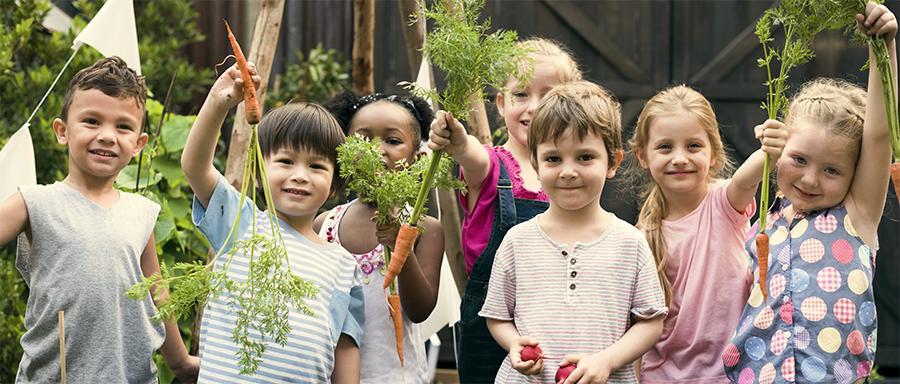 Local Food Initiative - kids with carrots