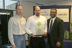 JB Instant Lawn accepting the award from Executive Sims