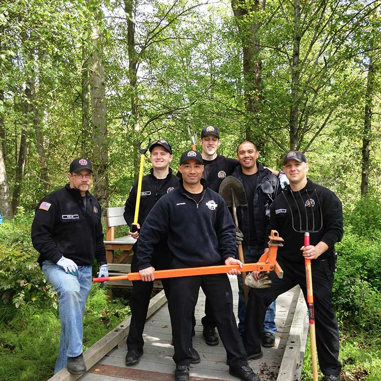 King County Skyway firefighters wielded the mighty weed wrenches to remove Scot's Broom from Skyway Park