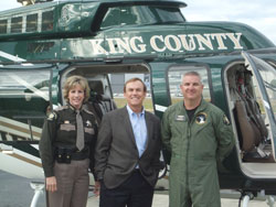 "King County Sheriff Sue Rahr and King County Councilmember Pete von Reichbauer stand in front of the King County Sheriff Air Support Unit's new ""Guardian One"" helicopter."
