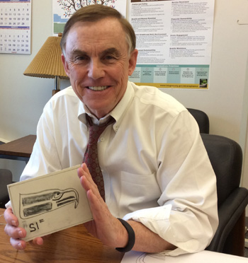 Image: King County Councilmember Pete von Reichbauer, shows off his Seahawks Linocut print at the King County Courthouse.